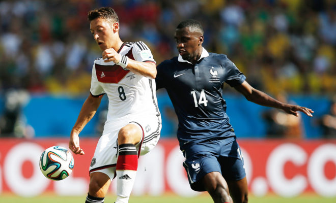 Germany's midfielder Mesut Ozil  (L) and France's midfielder Blaise Matuidi vie for the ball during the quarter-final football match between France and Germany at the Maracana Stadium in Rio de Janeiro during the 2014 FIFA World Cup on July 4, 2014. AFP PHOTO / ADRIAN DENNIS / AFP PHOTO / ADRIAN DENNIS