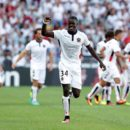Nice's French defender Malang Sarr celebrates with teammates after scoring a goal during the French L1 football match between Nice and Rennes on August 14, 2016, at the Allianz Riviera stadium in Nice, southeastern France.  / AFP PHOTO / JEAN CHRISTOPHE MAGNENET