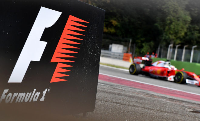 The Formula One logo is seen as Scuderia Ferrari's German driver Sebastian Vettel drives  during the second practice session at the Autodromo Nazionale circuit in Monza on September 2, 2016 ahead of the Italian Formula One Grand Prix. / AFP PHOTO / ANDREJ ISAKOVIC