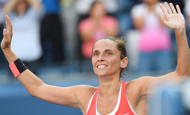 Sep 11, 2015; New York, NY, USA; Roberta Vinci of Italy reacts after beating Serena Williams of the USA on day twelve of the 2015 U.S. Open tennis tournament at USTA Billie Jean King National Tennis Center. Mandatory Credit: Robert Deutsch-USA TODAY Sports